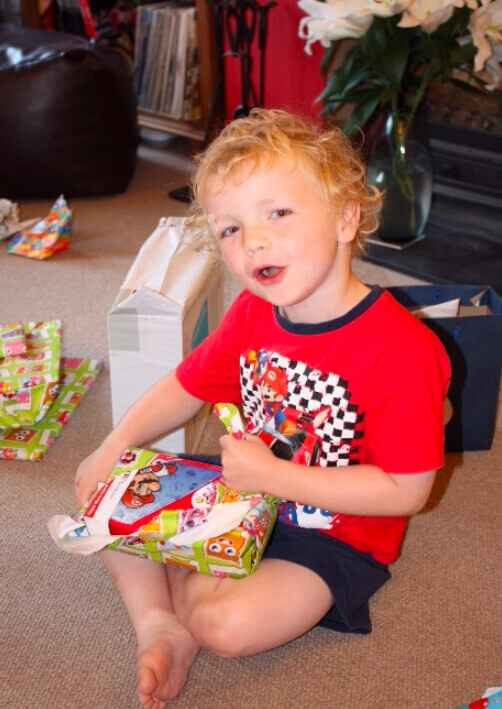 Harry opening gifts
